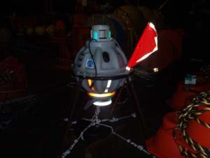 The buoy at night.