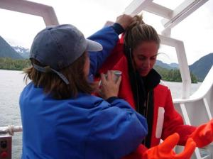 "Teacher at Sea, Jessica Schwarz into her immersion suit after an abandon ship drill.  ""Gumby suit"" was keeping Jessica Schwarz very warm for the moment!"