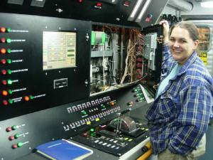 Assistant Engineer Kelly Baughman at the center console in the engine room onboard the RAINIER.  Kelly fired up the engines to get the ship underway this morning!