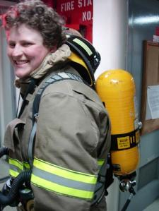 Showing off her air tank, OS Megan Guberski is dressed to fight a fire!