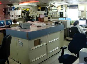 The Plot Room onboard NOAA ship RAINIER.  After data is collected from the survey boats, it is cleaned and processed by night processors in this room.