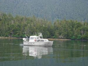Survey launch RA5 working in Kanga Bay in Southeast Alaska. The cruising speed of RA5 is up to 25 knots, but while on the survey line logging data, the boat can go no more than 8 kts.