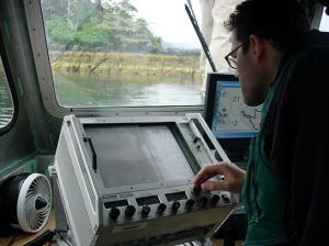 ENS Jamie Wasser, monitoring the Echosounder onboard RA1 during investigative surveys.