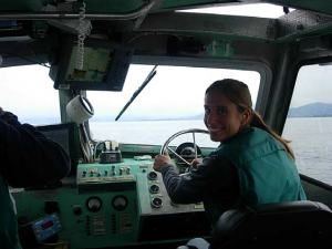 After finishing investigations, TAS Jessica Schwarz is getting a feel for steering a jet-propelled boat!