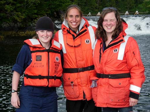 ENS Megan McGovern, TAS Jessica Schwarz, and ST Erin Campbell are spending their evening on the skiff to watch the salmon jump in Redoubt Bay in Southeast Alaska.