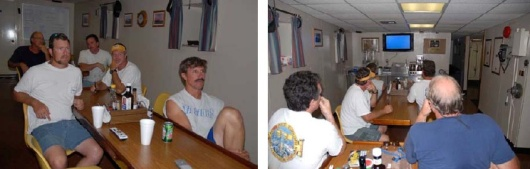"""In what quickly became a """"tradition,"""" the members of the science team and crew gather in the galley to attentively watch an ROV dive on the big screen TV.  Cheers and jeers would echo as a big grouper or snapper appeared or was lost from view.  Clockwise from left in front view, Andy David (PI), Steve Matthews(Fisheries Specialist), Tim Freeley (Chief Engineer), Darin Schuster(Winch operator), and Wayne Stewart (Crane operator)."""