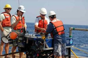 Members of the science team and crew prepare to deploy the ROV in Option 2 off the coast of North Florida aboard the NASA ship FREEDOM STAR.