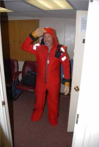 """Mark Silverman, NOAA Teacher at Sea, practices the use of his """"Gumby"""" survival suite.  The suit is designed to assist survival at sea should a ship go down."""