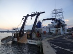 The picture shows where the HabCam is put into the water (left) and the scallop dredge (right).