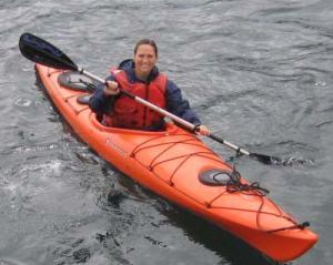 TAS Kim Wolke kayaking in Porpoise Harbor in the Shumagin Islands in Alaska