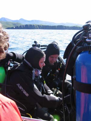 SST Erin Campbell and SS Corey Muzzey check each other's dive equipment before a dive.