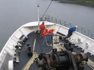 Deckhands at work as NOAA ship RAINIER departs Kodiak Island.