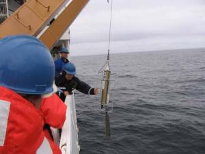 ENS Olivia Hauser retrieves the CTD, which contains data that will provide a baseline reading of the speed of sound through the water.  This information will assist in the sonar readings that will be taken of the sea floor.