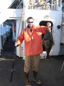Assistant Survey Technician Nick Gianoutsos showing off his SECOND halibut!