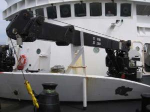 A crane on the bow of NOAA   ship RAINIER