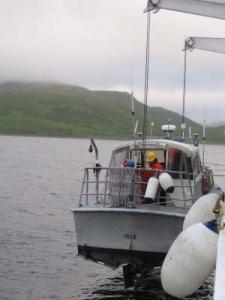 Lowering a survey launch off of NOAA ship RAINIER