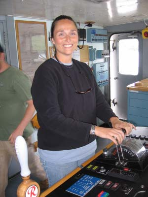 TAS Kim Wolke at the engine controls on NOAA ship RAINIER
