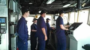 Several NOAA Corps Officers on the bridge while coming in to port in Kodiak.