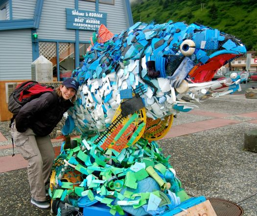 Avery next to a recycled fish