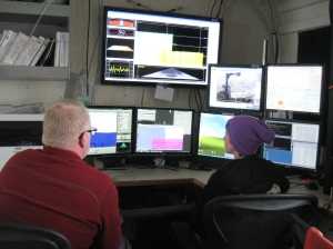 Randy (left) and Brandy (right) working on ship survey by monitoring the systems, drawing lines for navigation, and ensuring that good data is being collected.