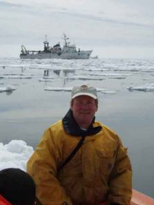 Mr. Jenkins with NOAA Ship MILLER FREEMAN in the background.