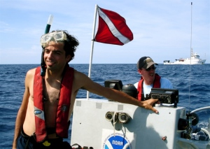 Thomas Nassif aboard the NF4 dive boat. The NANCY FOSTER is pictured in the background.