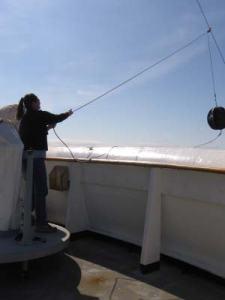 TAS Kim Wolke hoisting up the anchor ball as NOAA ship RAINIER anchors in East Bight of Nagai Island, AK