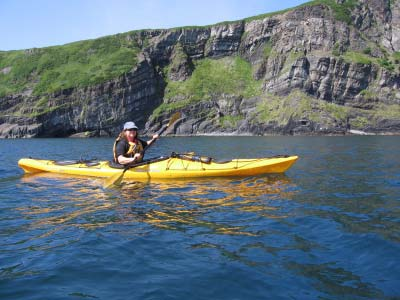 CDR Julia Neander, acting Commanding Officer of RAINIER, kayaking in East Bight of Nagai Island