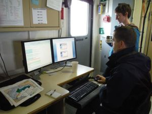 Survey Tech Brandy Geiger and ENS Wall begin to upload the data and organize it into files.