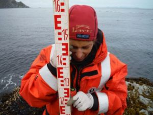 I used a level to make sure the rod was plumb--perpendicular to the benchmark.  No easy feat with a strong wind blowing!