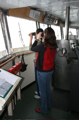 Elizabeth Labunsk and Third Mate Alison Paz surveying Bering Sea birdlife