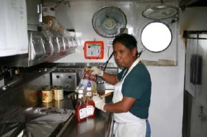 Raul in the kitchen and below are some of our galley