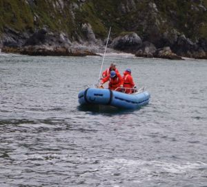 Setting off in a skiff to check on the Bird Island tide gauge.