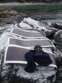 The solar panels that charged the batteries were intact, still tied into bolts in the rocks.
