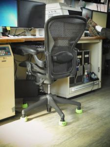 If your chair isn't tied down, put tennis balls over the wheels to keep it from rolling!