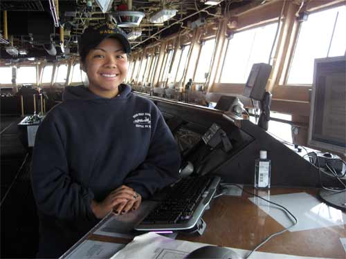 Working on the Bridge using the computer to record all ships operations during her four hour watch.