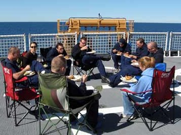With plates laden, the crew and scientists alike sit down for a glorious evening on board the HEALY.