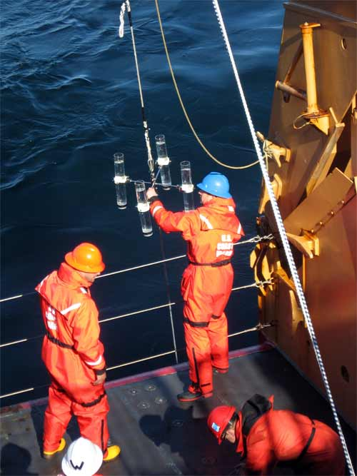 The scientists making sure the trap is ready before being deployed off the back deck of the vessel.