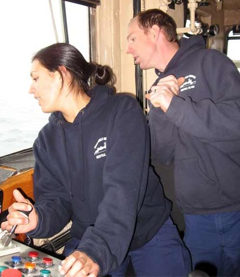 FN Angela Ford learning how to operate the winches with excellent guidance from MST1 Chuck Bartlett.