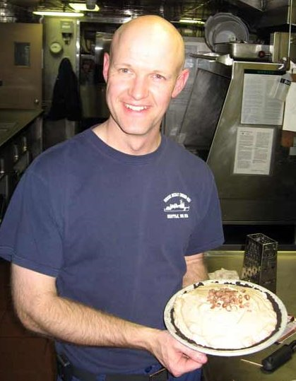 XO Commander Bateman teaching me how to make a delicious pie.