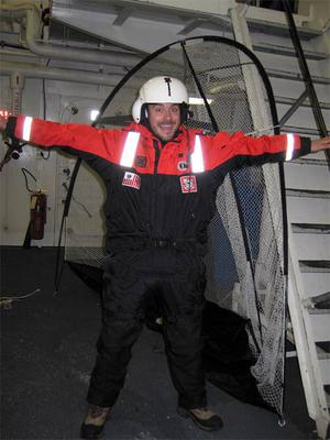 Dr. David dons the MS 900 survival suit prior to his flight in the helicopter.