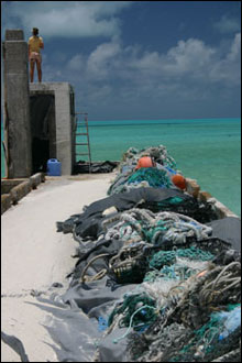 Old fishing nets get piled up on the pier on Green Island at Kure Atoll waiting for the marine debris crew to pick up