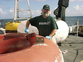 Rick painting the buoy