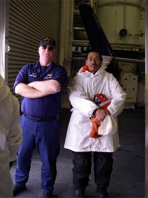 Lee Harris stands next to Captain Lindstrom. The Healy supports scientific research by facilitating technology and equipment dispersal.