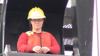 Jodie operates the crane that is used to lower the launch into the water; she is signaled with both verbal and visual commands.