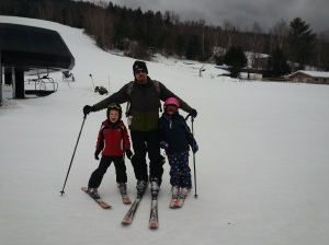 Chris & kids skiing