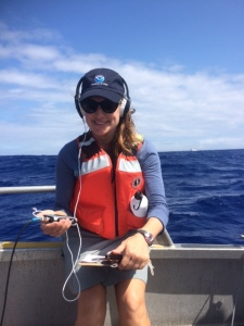 Listening to whales using the hydrophone during small boat operations.