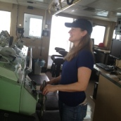At the helm with the help of the Bridge officers.