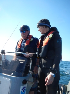 Coxswain Jim Pontz and Chief Scientist returning to the Nancy Foster after a successful dive