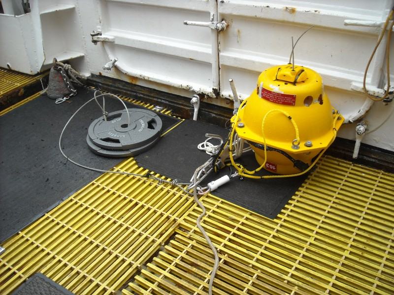 "This is the MARU. It is attached to 90 lbs of weight to sink it to the bottom. It will detach from these weights when the scientist send a signal and ""po up"" to the surface."